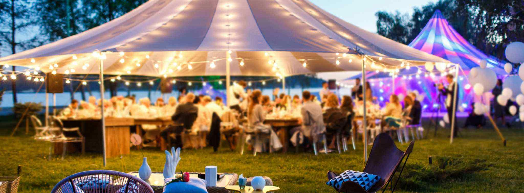 Wedding Guests in a Marquee - Example of our Services for Outside Wedding Caterers in Derby - Nottingham - Leicester - Bus Bar Hire Marquee Hire